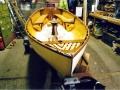 11ft 6in lugsail dinghy. Yellow cedar strip, iroko trim.